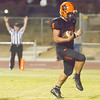 Woodlake senior RB Noe Garcia (4) celebrates scoring the winning touchdown in the Tigers 28-27 victory over the Corcoran Panthers. Garcia's touchdown came with 10 seconds left in the fourth quarter.