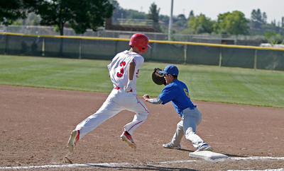 Lindsay Cardinal CF Isaiah Macias beats the thow to 1B in Wednesday's contest against the Corcoran Panthers.