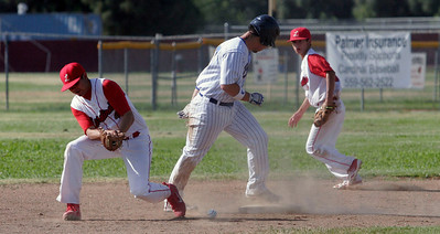 Corcoran Panther's third baseman Chris Hinohosa steals second against Lindsay as Isreal Uribe and Isaiah Macias retrieve the baseball on May 2, 2013.