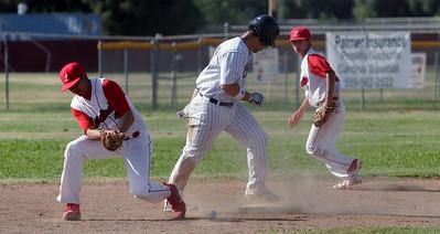 Corcoran Panther's third baseman Chris Hinohosa steals second against Lindsay as Isreal Uribe and Isaiah Macias retrieve the baseball on May 2, 2013.