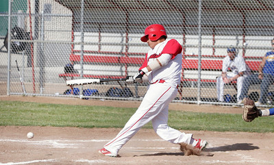 Lindsay Cardinal's infielder Vince Espinoza gets a hit against Corcoran on May 2, 2013. Lindsay wins the series against Corcoran 2 games to 1.