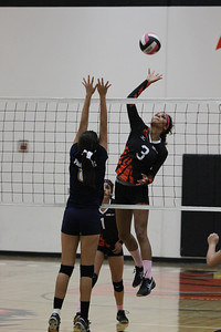 Woodlake Tiger volleyball player, KiAnna Cunningham goes high for one of her kills against Corcoran. The Tigers beat the Panthers 3-0 on Thursday, October 9th.