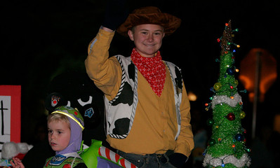 """Woody"" from Toy Story waves at the crowd of parade watchers at the Exeter Christmas Parade."