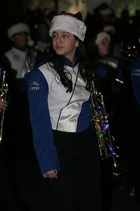A Wilson Middle School band member with a decorated trumpet at the Exeter Christmas Parade.