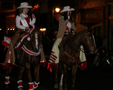 Springville Rodeo Princess Willow Werlhof (l) and Rodeo Queen Jada Lindegren (r) riding in the Exeter Christmas Parade.