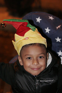 A young child awaiting the start of the Exeter Christmas Parade.