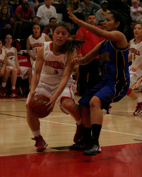 Lindsay Cardinal Destiny Garcia (1) drives for 2 of her 10 points  in Lindsay's 60-34 CIF Central Section Division IV semi-final. Lindsay won 60-34 to advance to the final.