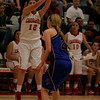 Lindsay Cardinal forward Alexis Gutierrez fires a three-point shot over Exeter's Jacque Hutcheson in Lindsay's 60-34 playoff victory on Wednesday, March 5th.