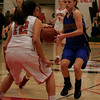 Exeter Monarch guard Jacque Hutchsen, being guarded by Lindsay's Alexis Gutierrez (12), had 15 points in their CIF Central Section Division IV semi-final game.