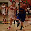 Lindsay Cardinal Destiny Garcia (1) chases Exeter Monarch guard Danica Todd during their CIF Central Section semi-final contest in Linday. The Cardinals won the contest 60-34.