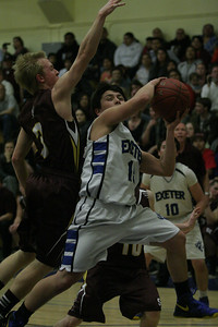 Exeter forward Harvey Brito attempts a shot past Sierra's Elijah Nora. February 27, 2013; Exeter 52 Sierra 40.