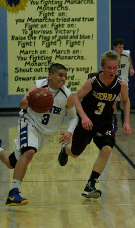 Exeter's Brandon Briones and Sierra's Elijah Nora (3) on February 27, 2013; Exeter 52 Sierra 40.