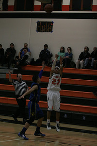 Woodlake Tiger guard Jaykob Rodriguez attempts a 3-point shot in Tuesday's contest against Exeter.