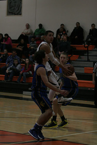 Woodlake Tiger guard Jacob Valera goes in for a layup in the Tiger's 73-43 loss to Exeter on January 8th.