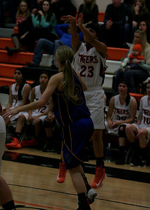 Woodlake Tiger Regina Ramirez (23) shots a three-point shot over Exeter guard Jacqueline Hutcheson (2). Woodlake defeated Exeter 43-37.