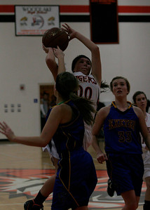 Woodlake's Gabby Diaz (00) drives the lane in the Tiger's 43-37 over the Exeter Monarchs on January 8th.