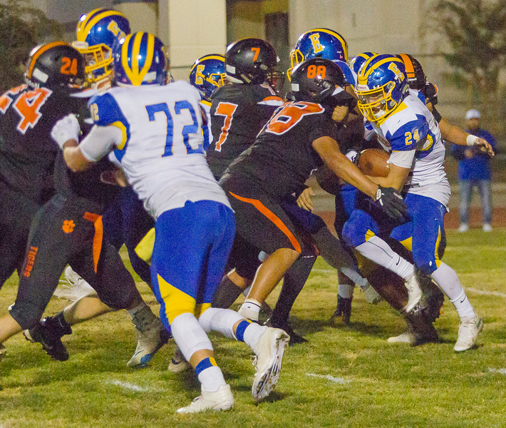 Exeter Monarch Nathaniel Heath (24) rushes the football in CIF Division 5 playoff action. Exeter would  go on to a 17-12 win