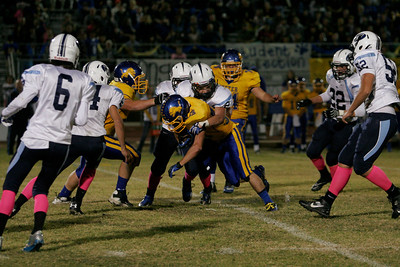 Yosemite DB Cody Elam takles Exeter Monarch Austin Cardoza during Friday's football game.