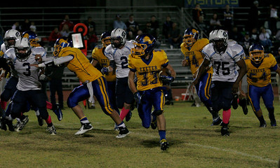 Exeter's Austin Cardoza (33) rushed for 141 yards against Yosemite on Friday, October 4, 2013.