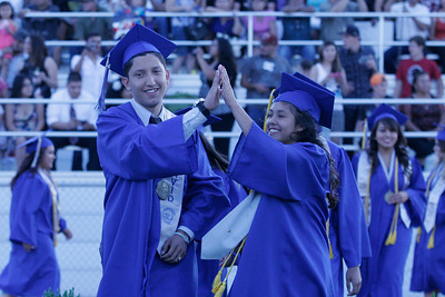 There were high fives all around during the processional into Aztec Stadium during the 2014 Farmersville High School Graduation ceremony on Friday, June 6, 2014.