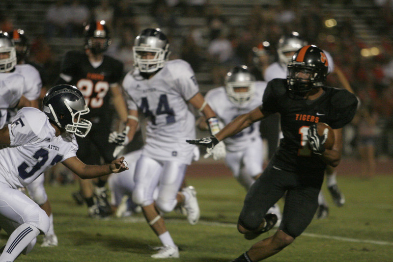 Woodlake Tiger Elijah Cunningham carried the ball 39 times in the Tiger's 29-28 win over Farmersville.