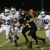 Farmersville Aztec runningback Jose Solis (23) attempts to evade Woodlake Tiger linebacker Jesse Ordonez (8).