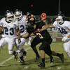 Farmersville Aztec runningback Jose Solis (23) attempts to evade Woodlake Tiger linebacker Jesse Ordonez (8).