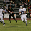 Farmersville Aztec runningback Joseph DeLaCruz (15) rushes the ball as Woodlakes Sam Palafox (50) pursues.