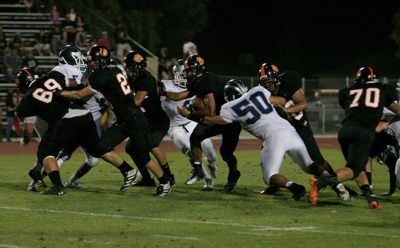 Woodlake Tiger Elijah Cunningham rushes for tough yards against the Farmersville Aztecs.
