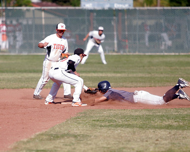 Farmersville Aztec pitcher Sam Metcalf was called out on this attempt to steal 2nd base during the final of the Ron Robinson Baseball Classic. The Woodlake Tigers defeated Farmersville 5-4.