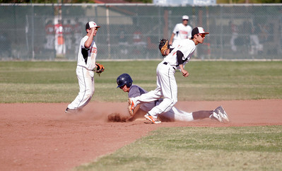 Woodlake Tiger 2nd Baseman Zach Fesperman and shortstop Eddie Pena react to the out signal during Farmersville pitcher Sam Metcalf's attempt to steal 2nd base.