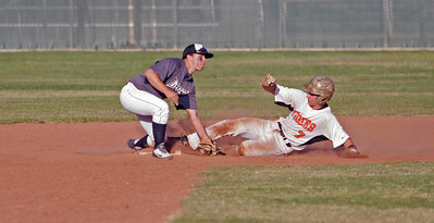 Woodlake's Gunner Litte is tagged out by Farmersville's Andrew Williamson during the final of the Rob Robinson Classic. Woodlake prevailed over Farmersville 5-4 to win the championship.