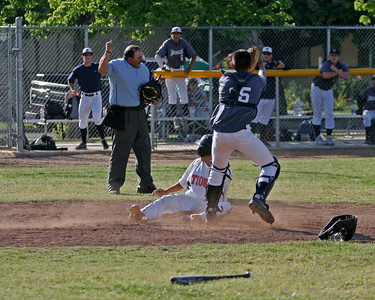 Farmersville catcher Edwin Quiroz tags Woodlake's Cornelio Ortiz out in a close play at the plate during the championship final of the Ron Robinson Classic. Woodlake went on to win by a 5-4 score.