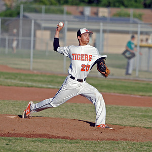 Eddie Pena (20) recorded the Save in Woodlake's 5-4 defeat of Farmersville in the Championship final of the Ron Robinson Classic.
