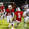 The Lindsay Cardinals used a high powered offence and a smothering defense to defeat the Fowler Redcats by a 41-20 score. Lindsay defenders (l-r) include Richard Diaz (7), Mathew Morales (28) and Mario Diaz (5).