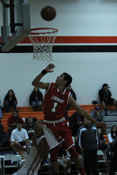 The Lindsay Cardinals played the Orange Cove Titans on Saturday, December 27th in the Frank Ainley Varsity Christmas Invitational Basketball tournament. R J Ruenda (1) drives for a layup.