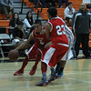 The Lindsay Cardinals played the Orange Cove Titans on Saturday, December 27th in the Frank Ainley Varsity Christmas Invitational Basketball tournament. Isaac Flores (5) dribbles around a screen set by Michael Alaniz (23) in the Cardinal's contest against the Titans.