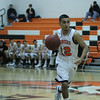 Woodlake lost a close contest against Tranquillity 54-50 on Saturday in the Frank Ainley Varsity Christmas Invitational basketball tournament. Cornelius Ortiz (12) brings the ball up court against Tranquillity .