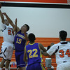 Woodlake lost a close contest against Tranquillity 54-50 on Saturday in the Frank Ainley Varsity Christmas Invitational basketball tournament. Tiger Chris Garcia (24) shoots over a Tranquillity Tiger defender.