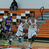 Woodlake lost a close contest against Tranquillity 54-50 on Saturday in the Frank Ainley Varsity Christmas Invitational basketball tournament. Woodlake Tiger guard Jacob Valera (1) leads the fast break at Tiger forward Jacob Moriado (23) takes a lane.