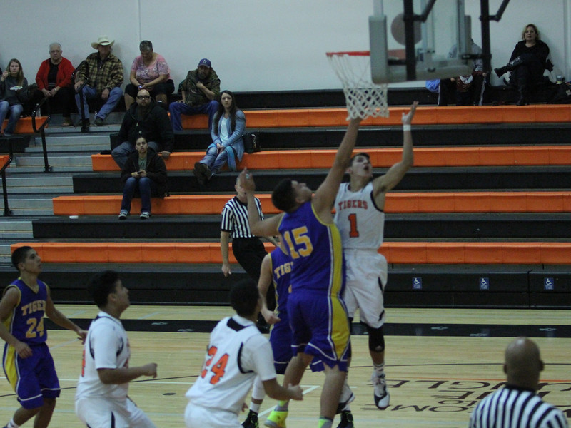 Woodlake lost a close contest against Tranquillity 54-50 on Saturday in the Frank Ainley Varsity Christmas Invitational basketball tournament. Woodlake guard Jacob Valera (1) shoots a lay up against the Tranquillity defense.