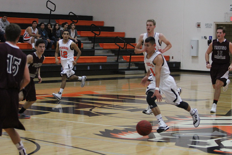 Jacob Valera brings the ball up court against Fresno Christian during Woodlake's non-league contest. Fresno Christian prevailed over Woodlake by a 62-44 score.