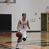 Woodlake Tiger guard Jacob Valera brings the ball up court against Fresno Christian. Woodlake came up short by a 62-44 score.