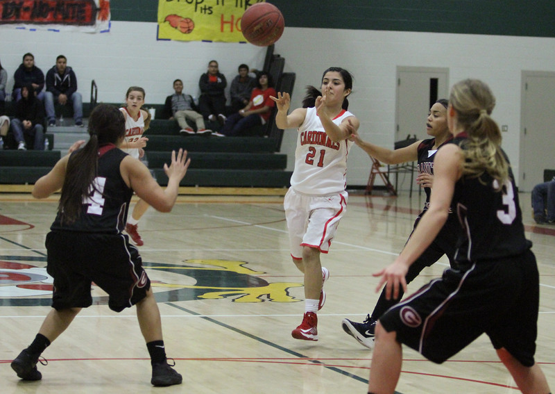 Lindsay Cardinal Danielle Jauregui (21) pushes the ball up court on a Cardinal fast break against the Granite Hills Grizzlies. The Cardinals lost to the visiting Grizzlies by a 55 - 48 score.