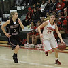 Lindsay Cardinal Maddie Caesar (21) dribbles up court against Granite Hills defender Sarah Vehrs. The Grizzlies held off the Cardinals by a 55 - 48 score in East Sequoia league play.