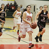 Marlene Gutierrez (20) of Lindsay goes for a lay up to finish a Cardinal fast break. The Cardinals lost to the visiting Grizzlies by a 55 -48 score.