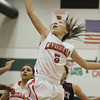 Lindsay's Raquel Gonzalez drives for 2 of her 19 points in the Cardinal's 55 - 48 loss to the Granite Hills Grizzlies on Friday. This was the Cardinals first league loss in 2 years.