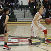Lindsay Cardinal guard Raquel Gonzalez (5) drives the ball up court against Ruby Espinoza (4) of Granite Hills. Gonzalez, a sophomore, tallied 19 points in the Cardinals' 55 - 48 loss to the Grizzlies.