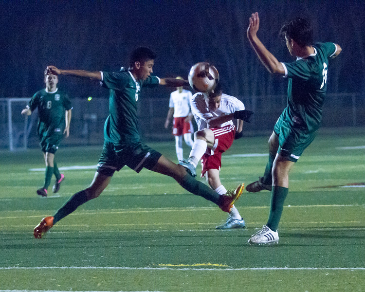 Lindsay defeated Garces Memorial 2-0 in CIF Division IV playoff action to advance to the quarterfinals against the Delano Tigers. Lindsay's Ivan Ceballos (8), center, gets off a shot between two Garces players.