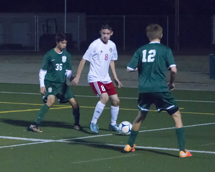 Lindsay defeated Garces Memorial 2-0 in CIF Division IV playoff action to advance to the quarterfinals against the Delano Tigers. Cardinal Ivan Ceballos maneuvers around two Garces players.
